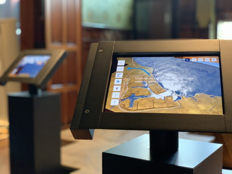 Close up of iPad with AR layer over model